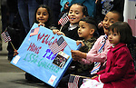 The children of Staff Sgt. Julio Guerrero, from left, Isabella, 7, Lelsie, 6, Pablo, 4, Brandon, 7 and Destiny, 3, wait for members of the 422nd Expeditionary Signal Battalion of the Nevada National Guard who returned home Sunday, Jan. 15, 2012, after a yearlong deployment to Afghanistan. Hundreds of family and friends greeted the soldiers at the Nevada Air Guard Base in Reno, Nev..Photo by Cathleen Allison