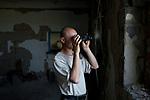 UKRAINE: Frontline of Kamyanka. An Ukrainian soldier  islooking at separatist positions with his binoculars. <br /> <br /> UKRAINE: Frontline de Kamyanka. Un soldat ukrainien regarde vers les positions séparatistes avec ses jumelles.