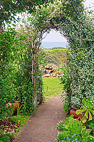 View of ocean through garden arch. Greenwood Pier. Elk, California