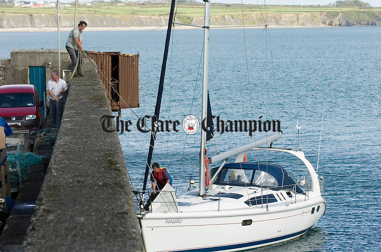 The Tranquillity, a 30ft Yacht is rercovered after it had a narrow escaope when it ran aground at Carrigaholt. Photograph by John Kelly