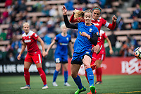 Seattle, WA - Saturday May 13, 2017: Beverly Yanez and Shelina Zadorsky  during a regular season National Women's Soccer League (NWSL) match between the Seattle Reign FC and the Washington Spirit at Memorial Stadium.