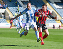 Dundee's James McPake holds off St Johnstone's Michael O'Halloran.