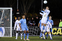 Akron Zips Ben Zemanski (13) heads the ball. The Akron Zips defeated the North Carolina Tar Heals 5-4 in penalty kicks after playing a scoreless game during the second semi-final match of the 2009 NCAA Men's College Cup at WakeMed Soccer Park in Cary, NC on December 11, 2009.