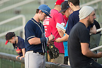 Brendan Rodgers (1) of the Asheville Tourists signs autographs prior to the game against the Kannapolis Intimidators at Kannapolis Intimidators Stadium on May 26, 2016 in Kannapolis, North Carolina.  The Tourists defeated the Intimidators 9-6 in 11 innings.  (Brian Westerholt/Four Seam Images)