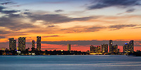 Colorful sunset on lit-up Miami skyline buildings, over Biscayne Bay, from Miami Beach Art Deco District, Florida USA