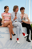 """CANNES, FRANCE - JULY 13:  French-Algerian actress Lyna Khoudri, US director Wes Anderson, French-Us actor Timothee Chalamet at photocall for the film """"The French Dispatch"""" at the 74th annual Cannes Film Festival in Cannes, France on July 13, 2021 <br /> CAP/GOL<br /> ©GOL/Capital Pictures"""
