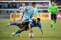 SAN JOSE, CA - AUGUST 17: Ethan Finlay #13 of Minnesota United tackles Marcos Lopez #27 of the San Jose Earthquakes during a game between San Jose Earthquakes and Minnesota United FC at PayPal Park on August 17, 2021 in San Jose, California.