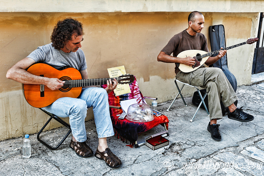 Musicians playing guitar and bouzouki in the street of Athens, Greece