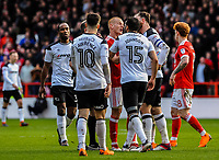 Derby County's defender Richard Keogh (6) and Nottingham Forest's midfielder Ben Watson (32) aregue after sending off during the Sky Bet Championship match between Nottingham Forest and Derby County at the City Ground, Nottingham, England on 10 March 2018. Photo by Stephen Buckley / PRiME Media Images.