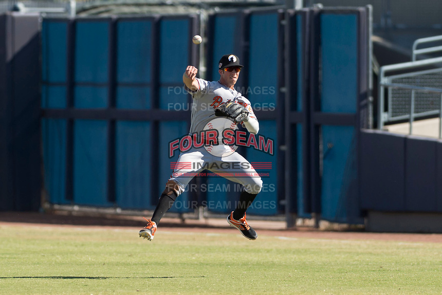 Glendale Desert Dogs second baseman Steve Wilkerson (12), of the Baltimore Orioles organization, makes a twisting throw to first base during an Arizona Fall League game against the Peoria Javelinas at Peoria Sports Complex on October 22, 2018 in Peoria, Arizona. Glendale defeated Peoria 6-2. (Zachary Lucy/Four Seam Images)