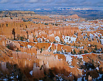 Bryce Canyon National Park, UT<br /> A spring snow covers the floor of the Bryce Amphitheater from Sunset Point with Boat Mesa and Sinking Ship in the distance.
