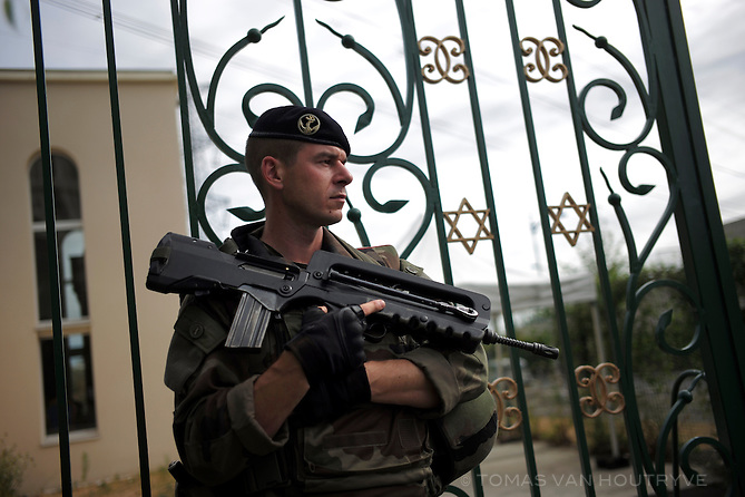 French soldier, Sergent Vincent (last name withheld), guards a synagog in Sarcelles, near Paris, France on 22 July, 2015.