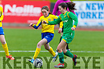 Andrea Murphy of Kerry pushes forward  as Ciara Shelly  of Tipperary keeps an eye on the ball during their U13 encounter on Sunday.