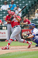 Memphis Redbirds outfielder Stephen Piscotty #33 swings the bat during the Pacific Coast League baseball game against the Round Rock Express on April 27, 2014 at the Dell Diamond in Round Rock, Texas. The Express defeated the Redbirds 6-2. (Andrew Woolley/Four Seam Images)