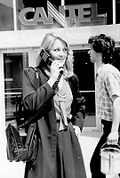 A call away: Kathy McLaughin of Cantel Inc. shows how portable the cellular telephone can be.