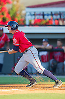 Mike Dodig (13) of the Danville Braves follows through on his swing against the Burlington Royals at Burlington Athletic Park on July 5, 2014 in Burlington, North Carolina.  The Royals defeated the Braves 5-4.  (Brian Westerholt/Four Seam Images)