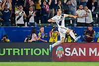 CARSON, CA - SEPTEMBER 15: Zlatan Ibrahimovic #9 of the Los Angeles Galaxy scores a goal and celebrates during a game between Sporting Kansas City and Los Angeles Galaxy at Dignity Health Sports Park on September 15, 2019 in Carson, California.