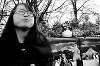 France. Ile-de-France Department. Paris. Avenue des Champs-Élysées. A chinese tourist and a fake snowman. Christmas decoration with a white polar bear hunter and a couple of pinguins. A group of tourists. 22.11.13 © 2013 Didier Ruef