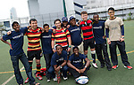 """HONG KONG - March 23, 2011:  The South Africa 7s team invited the Laureus supported Soweto Schools Rugby Project from South Africa to watch their training session at King Park Stadium.  The delegation was led by Laureus World Sports Academy Member Morne du Plessis, and Project Manager, Dali Ndebele.  The young players from Soweto were able to watch a high level coaching session by Paul Treu and his 7s squad, and were able to meet their role models in a special moment when shirts were exchanged. In return the Soweto team performed a special Soweto version of the """"Haka"""".  The young people from Soweto are in Hong Kong for a unique exchange visit which culminates in them being invited to attend the world-famous Hong Kong Rugby Sevens tournament. Photo by Victor Fraile for Laureus"""