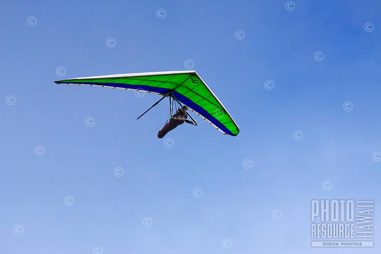 A man hang gliding over O'ahu.