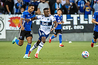 SAN JOSE, CA - AUGUST 13: Marcos Lopez #27 of the San Jose Earthquakes challenges Cristian Daaome #11 of the Vancouver Whitecaps during a game between San Jose Earthquakes and Vancouver Whitecaps at PayPal Park on August 13, 2021 in San Jose, California.