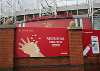 General view of a large sign on the approach to Old Trafford which reads, please wash your hands for twenty seconds, as football clubs continue to observe the Covid guidelines during Manchester United vs Brentford, Friendly Match Football at Old Trafford on 28th July 2021