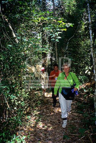 Tataquara, Brazil. Ecotourists on a jungle walk through the rainforest with guide.