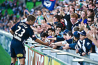 MELBOURNE, AUSTRALIA - DECEMBER 27: Adrian Leijer of the Victory with fans after the round 20 A-League match between the Melbourne Victory and the Newcastle Jets at AAMI Park on December 27, 2010 in Melbourne, Australia. (Photo by Sydney Low / Asterisk Images)