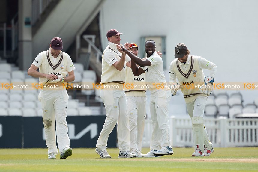 Team mates celebrate with wicket taker Kemar Roach, Surrey CCC during Surrey CCC vs Hampshire CCC, LV Insurance County Championship Group 2 Cricket at the Kia Oval on 1st May 2021