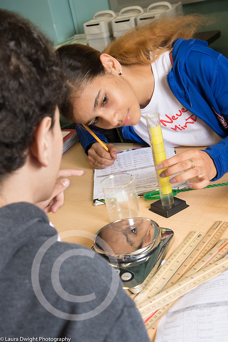 Education high school science class male and female students working together on lab