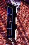 Crumbling brick surrounds window in abandoned boys reformatory, San Luis Obisop, CA