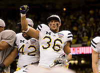 Zac Johnson of Michigan celebrates after winning Sugar Bowl game against Virginia Tech at Mercedes-Benz SuperDome in New Orleans, Louisiana on January 3rd, 2012.  Michigan defeated Virginia Tech, 23-20 in first overtime.