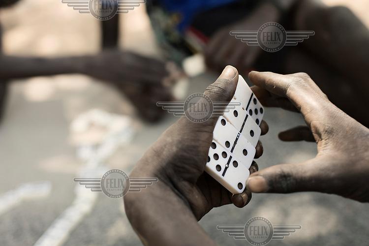 Children playing dominos.