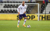 SWANSEA, WALES - NOVEMBER 12: John Brooks #6 of the United States looks for an open man during a game between Wales and USMNT at Liberty Stadium on November 12, 2020 in Swansea, Wales.