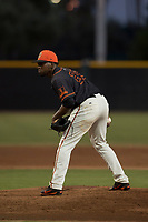 AZL Giants Black relief pitcher Aneudy Acosta (29) looks to his catcher for the sign during an Arizona League game against the AZL Athletics at the San Francisco Giants Training Complex on June 19, 2018 in Scottsdale, Arizona. AZL Athletics defeated AZL Giants Black 8-3. (Zachary Lucy/Four Seam Images)
