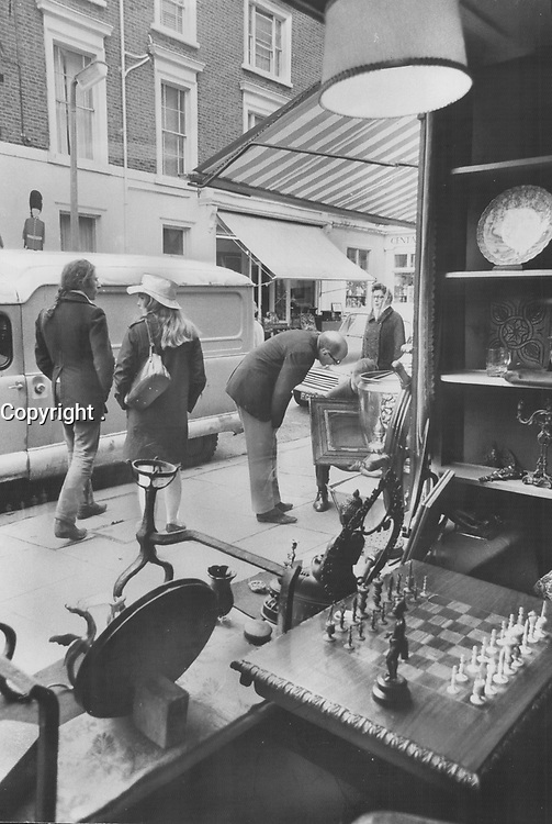 1974 FILE PHOTO -<br /> <br /> Real treasures are seldom stumbled on by casual shoppers but a day of browsing through the antique shops and junk stores of London can still be rewarding if you keep an eye peeled for the unusual; something that will make a more meaningful souvenir than a postcard view of of Big Ben.