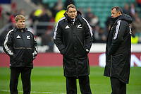 The All Blacks coaches (L-R) Brian McLean, Defence Coach, Steve Hansen, Head Coach, and Ian Foster, Assistant Coach during the QBE Autumn International match between England and New Zealand at Twickenham on Saturday 01 December 2012 (Photo by Rob Munro)