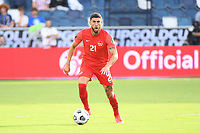 KANSAS CITY, KS - JULY 15: Jonathan Osorio #21 of Canada with the ball during a game between Canada and Haiti at Children's Mercy Park on July 15, 2021 in Kansas City, Kansas.