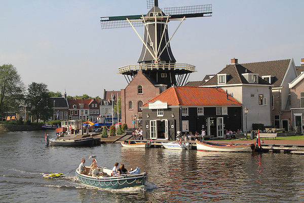 The De Adriaan Windmill Museum and boaters on the Spaarne River, Haarlem, Holland, Netherlands. .  John offers private photo tours in Denver, Boulder and throughout Colorado, USA.  Year-round. .  John offers private photo tours in Denver, Boulder and throughout Colorado. Year-round.