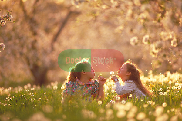 young girls playing in orchard