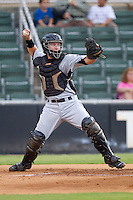 Catcher Zach Zaneski #17 of the Hickory Crawdads makes a throw to second base between innings of the game against the Kannapolis Intimidators at Fieldcrest Cannon Stadium August 18, 2010, in Kannapolis, North Carolina.  Photo by Brian Westerholt / Four Seam Images