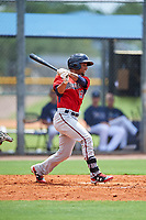 GCL Twins center fielder Jean Carlos Arias (13) hits a single during the first game of a doubleheader against the GCL Rays on July 18, 2017 at Charlotte Sports Park in Port Charlotte, Florida.  GCL Twins defeated the GCL Rays 11-5 in a continuation of a game that was suspended on July 17th at CenturyLink Sports Complex in Fort Myers, Florida due to inclement weather.  (Mike Janes/Four Seam Images)