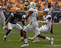 Georgia Tech runner Qua Searcy (1) receives a pitch from quarterback TaQuon Marshall as Pitt linebacker Saleem Brightwell (9) looks on. The Pitt Panthers football team defeated the Georgia Tech Yellow Jackets 24-19 on September 15, 2018 at Heinz Field in Pittsburgh, Pennsylvania.