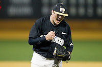 Wake Forest Demon Deacons relief pitcher Garrett Kelly (28) reacts after getting the final out in the game against the Georgetown Hoyas at Wake Forest Baseball Park on February 16, 2014 in Winston-Salem, North Carolina.  The Demon Deacons defeated the Hoyas 3-2.  (Brian Westerholt/Four Seam Images)