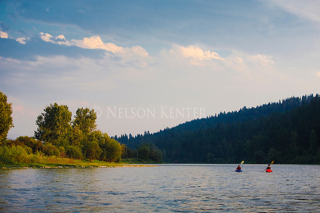 Two kayakers enjoy an evening float down the Bitterroot River through Missoula, MT
