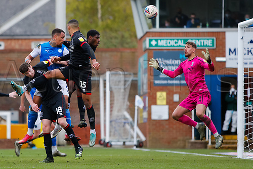 1st May 2021; Weston Homes Stadium, Peterborough, Cambridgeshire, England; English Football League One Football, Peterborough United versus Lincoln City; Alex Palmer of Lincoln City watches the ball as Jonson Clarke-Harris of Peterborough United heads towards goal at a corner