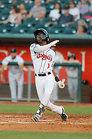 Lansing Lugnuts second baseman Samad Taylor (1) follows through on a swing during a game against the Dayton Dragons at Cooley Law School Stadium on August 10, 2018 in Lansing, Michigan. Lansing defeated Dayton 11-4.  (Robert Gurganus/Four Seam Images)