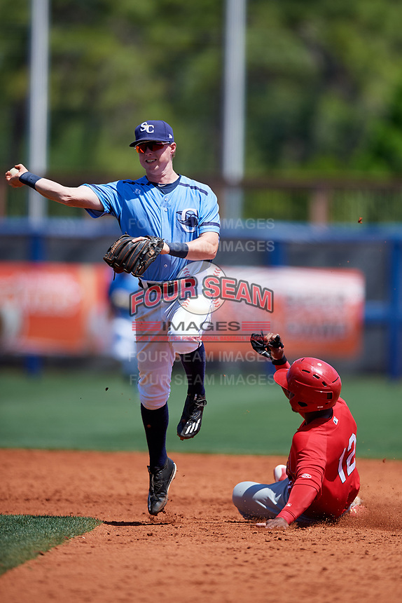 Charlotte Stone Crabs shortstop Jake Cronenworth (2) turns a double play during a game against the Palm Beach Cardinals on April 12, 2017 at Charlotte Sports Park in Port Charlotte, Florida.  Palm Beach defeated Charlotte 8-7.  (Mike Janes/Four Seam Images)