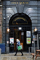 Pictured: The Bank Statement, a Wetherspoon pub in Wind Street, the main bar and restaurant district remains deserted in the city centre of Swansea, Wales, UK. Monday 30 November 2020<br /> Re: Pubs and restaurants will have to stop serving alcohol shut at 6pm from this Friday due to the Covid-19 Coronavirus pandemic, Wales, UK.