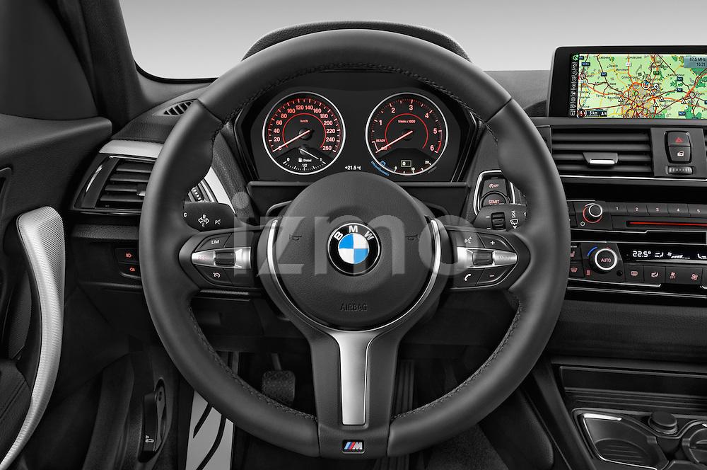 Car pictures of steering wheel view of a 2015 BMW 1 Series M Sport 5 Door Hatchback Steering Wheel